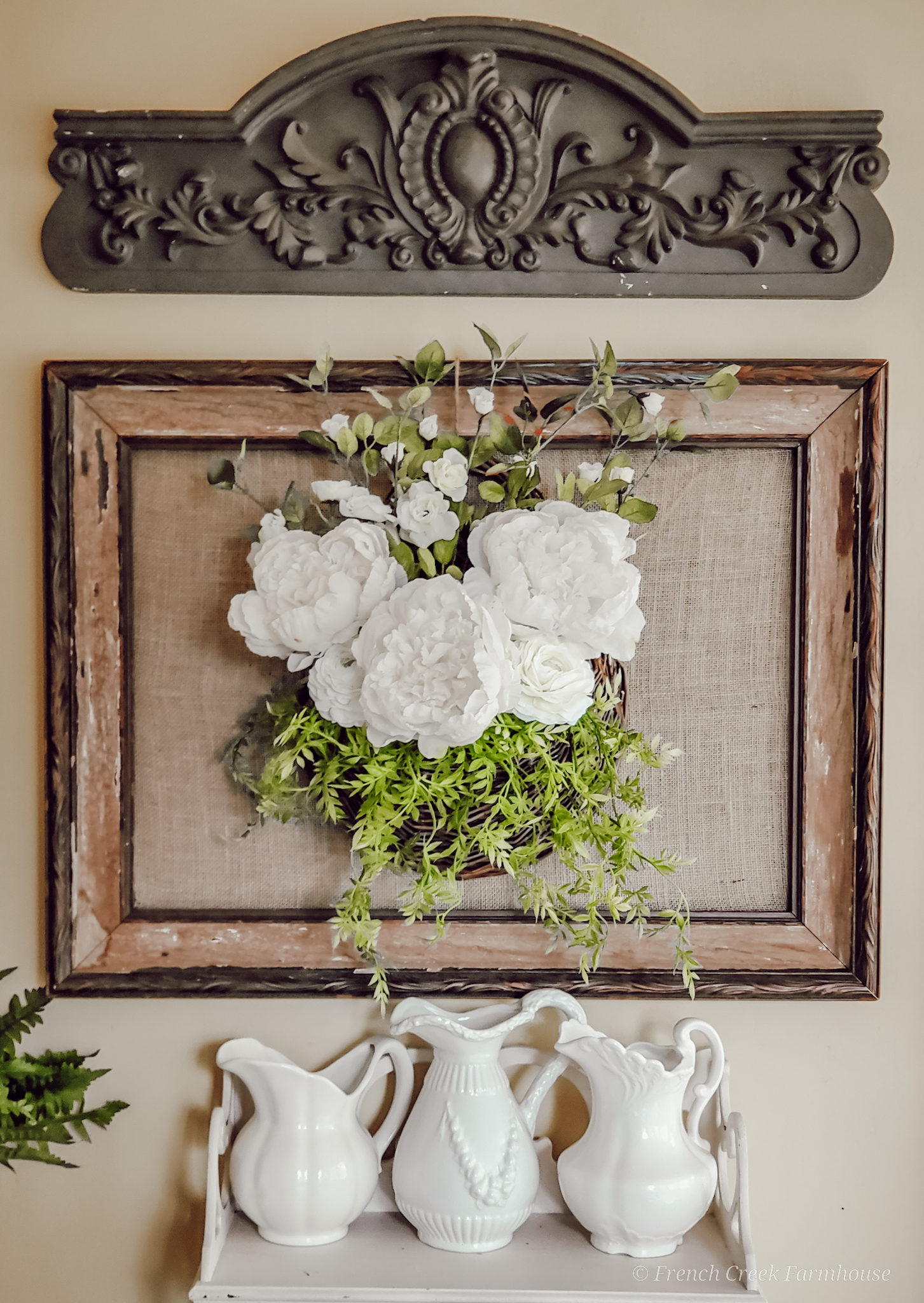 An old picture frame is a beautiful backdrop for floral arrangements