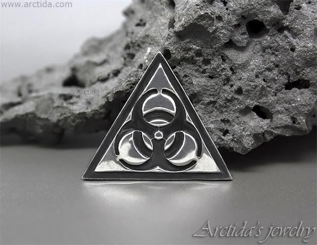 http://www.arctida.com/en/home/120-science-jewelry-biohazard-necklace-fine-silver-pendant-on-leather-cord.html