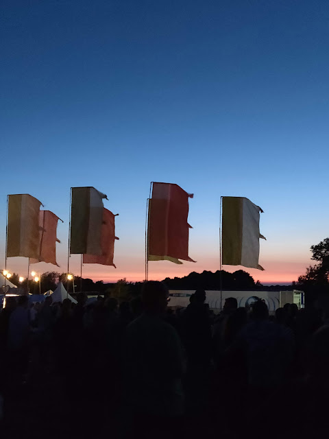Cornbury Music Festival flags at dusk.