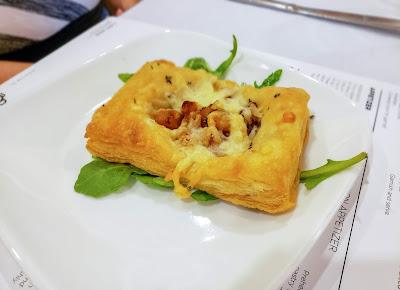 An Envy Apple & Carmelized Onion pastry appetizer