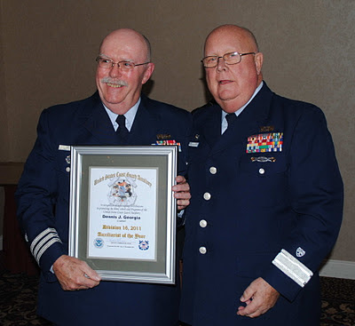 "Dennis Georgia, 2011 Auxiliarist of the Year with Commodore Harold ""Robbie"" Robinson"