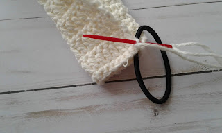 attaching a crochet scrunchie to a hair tie