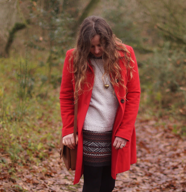 Girl in a red coat in winter