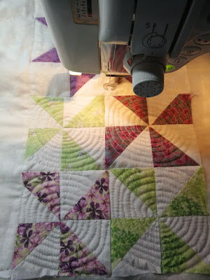 FMQ spirals in each pinwheel block