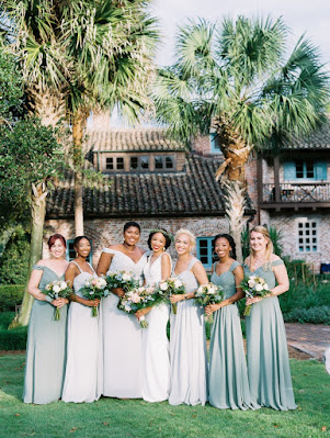 bridesmaids in shades of green long dresses