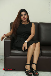 Tollywood Upcoming Actress Pooja Roshan Stills in Black Short Dress at Plus 1 Movie Trailer Launch  0324.JPG