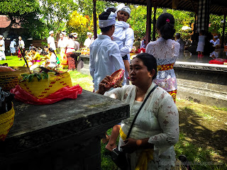Offering And Praying To The Dead Souls During Galungan Holiday At Dalem Temple Ringdikit