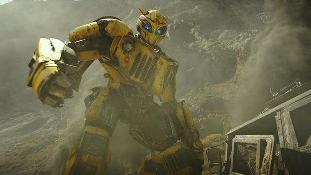a sportscar transformers bumblebee standing and staring in front of devastated place with scrap metals