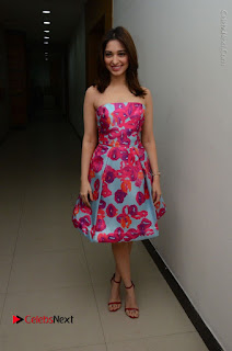 Actress Tamanna Latest Images in Floral Short Dress at Okkadochadu Movie Promotions  0158.JPG