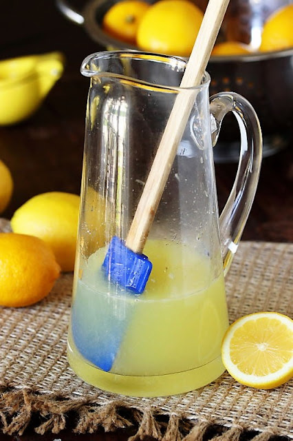 Dissolving Sugar in Lemon Juice to Make Homemade Lemonade Image