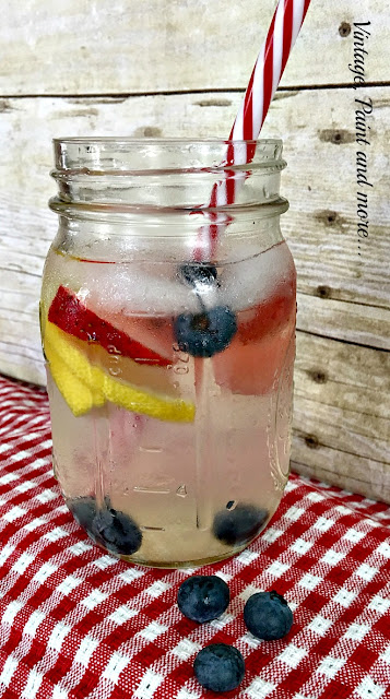 Vintage, Paint and more... making a delicious cool drink with water, strawberries, blueberries and lemons