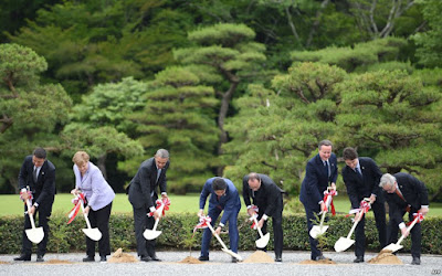 G7 leaders shovel soil in tree-planting ceremony