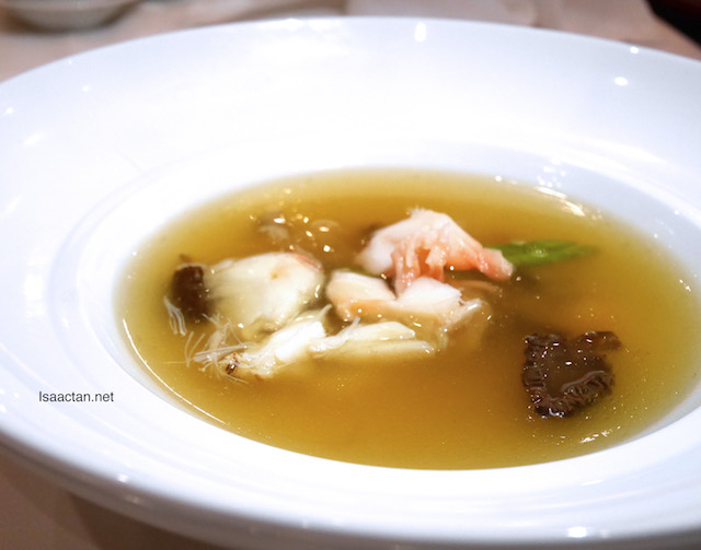 Lobster consommé, morel mushroom with fresh crab meat and sea treasure soup