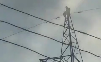 Pastor Climbs A High Tension Electric Pole, Threatens To Jump Down In Aba (Video)