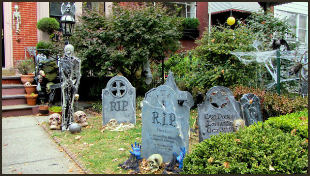 Create your own graveyard in your front garden by creating tombstones with foam boards.