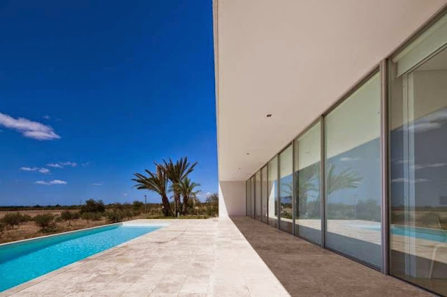 large glass windows Modern House with Pool in Tavira