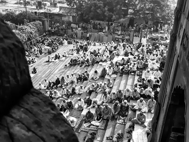 Aaditya visited Jama Majid and brought us some beautiful shots of the Eid Celebrations and prayers being offered. altWhile offering the prayers, people stand in queues, shoulder to shoulder, rich, poor, old, and young alike. This has been beautifully captured in thispicture.The pigeons fly above Jama Masjid as people offer prayers below. The picture speaks of peace and serenity.All devotees are equal before Allah, and on this auspicious day, all are in His presence - Blessed!Dear Allah, I leave my human ego behind and bow before you. You and only you are The Supreme Being. Devotees throng the premises of Jama Masjid. Those who can't get in, sit outside. There is no place in this world which is devoid of the presence of thLord, be it inside or outside the mosque. Any alms given in your name, My Lord, shall only go to those who need help. It is my promised that it will be used for good cause.
