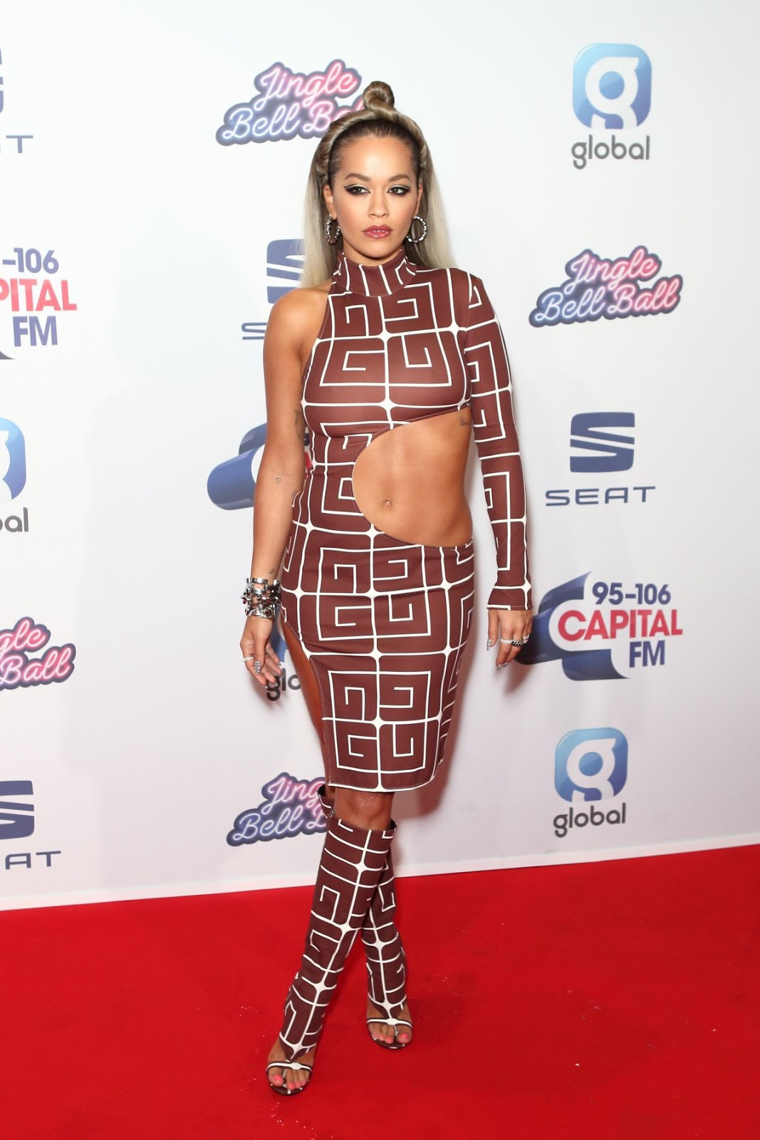 Rita Ora flashes toned midriff in quirky ensemble at the Capital Jingle Bell Ball 2019 in London