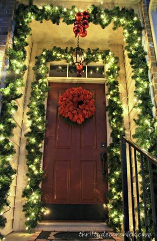 garland around front door and porch