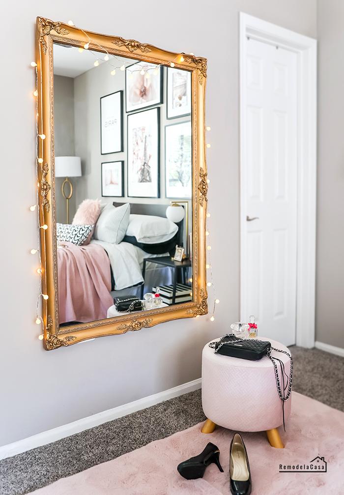 Glam Paris bedroom with antique gold mirror
