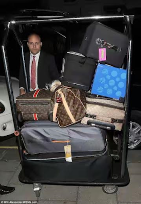 mariah carey's huge designer luggage set seen with her on her london travel