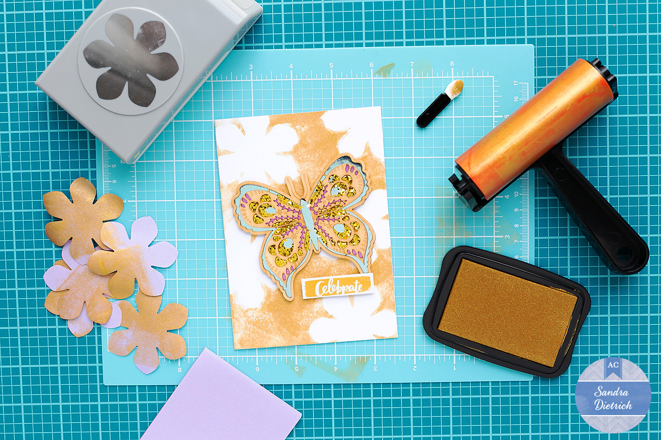Pretty butterfly background on a card made with the diy shop brayer by American Crafts