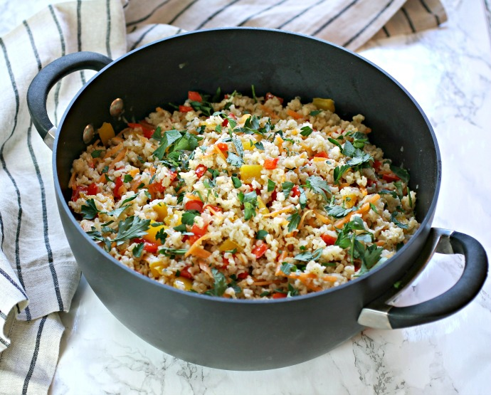 Recipe for a rice pilaf with onions, peppers and carrots.