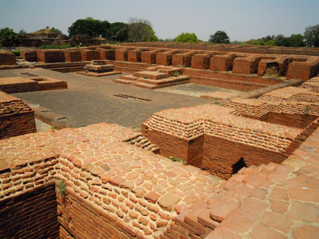 "A view of the layout of a typical monastery in Nalanda from the second floor.The central square courtyard was the ""classroom"". There are 34 identical rooms arranged around this square courtyard."