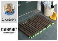 Etched wood door mat