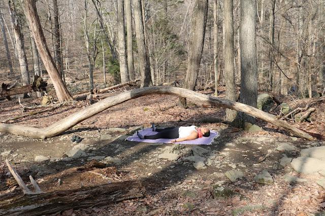 practicing savasana outdoors