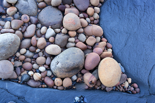 Saltwick Bay pebble collection by Martyn Ferry Photography