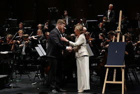 Final of the Queen Sonja International Music Competition 2019 - First prize winner, Sergey Kaydalov (Russia) & H.M. Queen Sonja on Norway (Photo Adrian Nielsen)