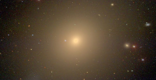 The giant elliptical galaxy NGC 4472. Courtesy of David W. Hogg, Michael R. Blanton, and the Sloan Digital Sky Survey Collaboration.