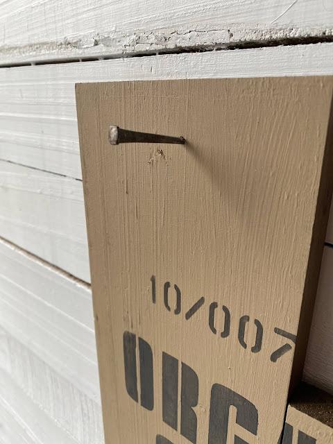 Photo of a masonry nail in a board