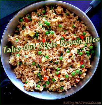 Take-Out Style Brown Rice, a quick flavorful side dish. Don't go pick it up, make it at home.  | Recipe Developed by www.BakingInATornado.com | #recipe #dinner