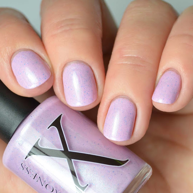 orchid nail polish with flakies four finger swatch