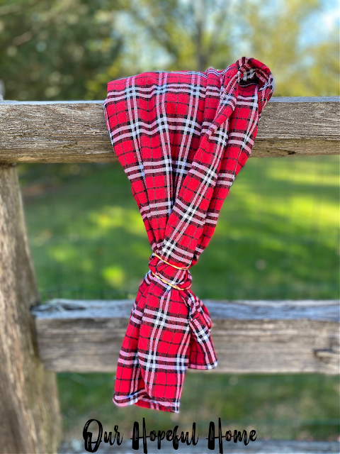 flannel shirt on fence