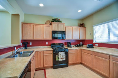 Cool We started with Builder special maple cabinets Beige laminate countertops Black appliances and Porcelain tile flooring