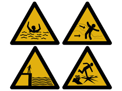 4 official warning signs in black and yellow
