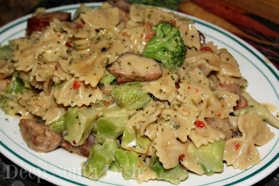 A quick skillet meal, made from andouille sausage, broccoli, leftover, cooked veggies, bow tie pasta, and a touch of sour cream added at the end for creaminess.