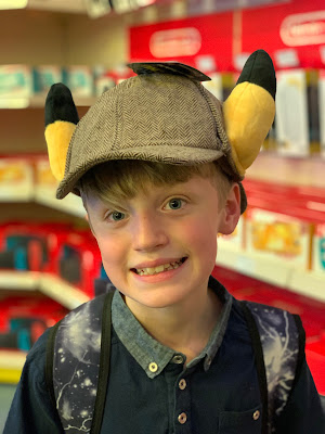 boy wearing Detective Pikachu hat with ears