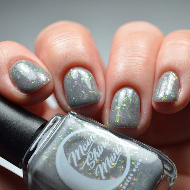 grey nail polish with flakies low light swatch
