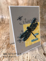 This image shows a handmade card with a black dragonfly on top of a piece of honeycomb cardstock, made with Stampin' Up! products