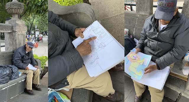 abuelito vendiendo dibujos para sobrevivir en la pandemia