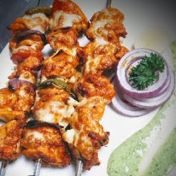 Serving Chicken kebab with green chutney, onion slices for chicken kebab recipe