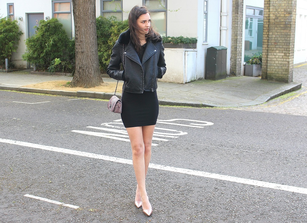 peexo fashion blogger wearing leather jacket and little black dress and snake print bag and rose gold heels