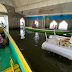 Filipino priest celebrates mass in a flooded chapel in Bulacan