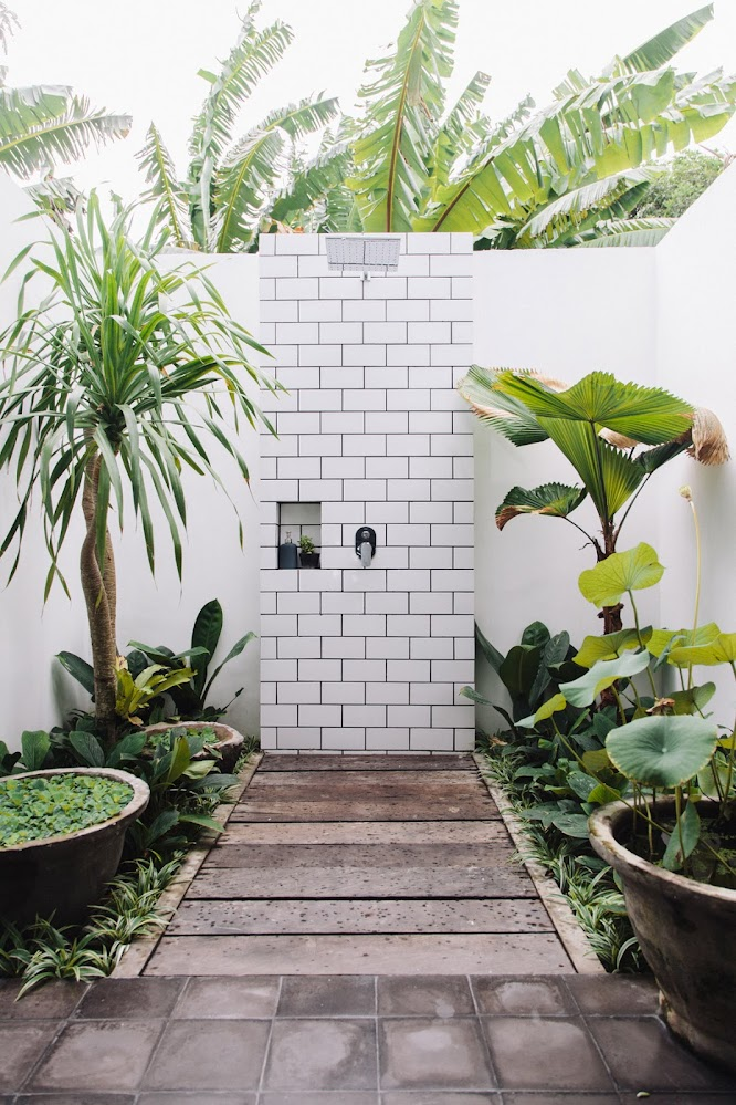 tiled-plinth-potted-plants-outdoor-shower-fixtures