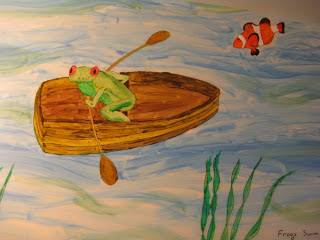 A painting of a frog rowing a boat, with a clownfish in the nearby water, done by T. Baumgartner