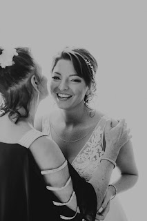 Candid photos of bride with family.